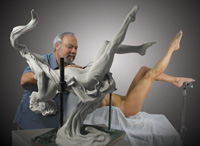 Leon Richman sculpting with live model